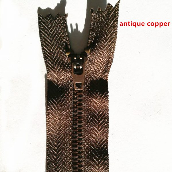 Purple bronze zip with double sliders arranged in head to head