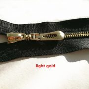 No.5 zipper with light gold teeth and  auto lock slider